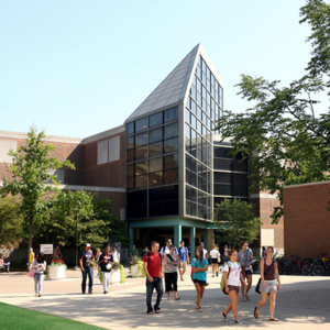 Students walk near Olscamp Hall