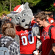Mr. Wuf with students