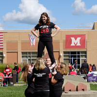 cheerleaders doing a lift