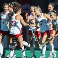 field hockey team celebrating