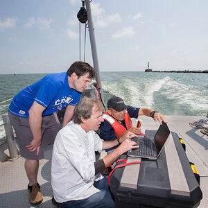 students and instructor on a boat in Lake Erie